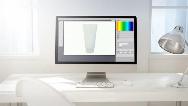 Espacio de trabajo con pantalla de computadora haciendo diseño de producto