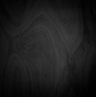 Esquina de primer plano de grano de madera hermoso fondo abstracto negro natural en blanco para el diseño