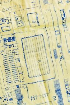 Estampado azul sobre textil amarillo.