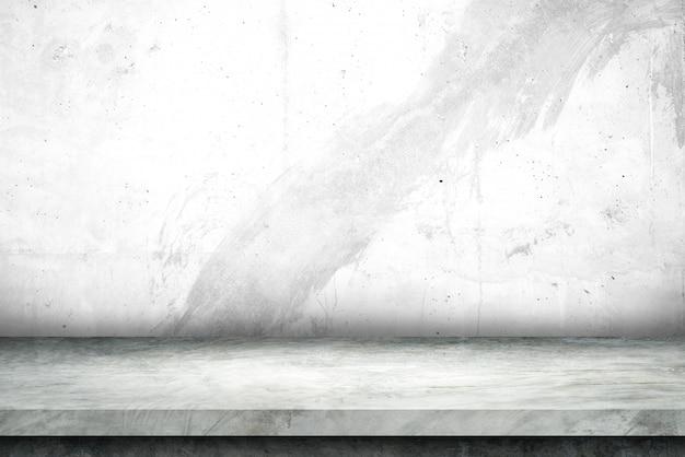 Estante de cemento y fondos de muro de hormigón desnudo