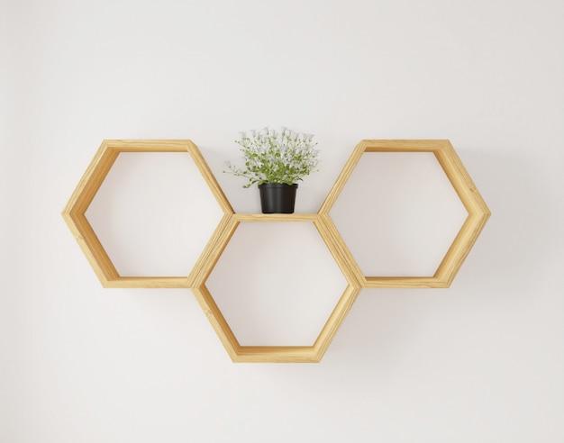 Estante hexagonal y flor en la pared