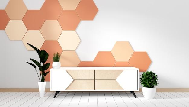 Estante de la televisión en la habitación vacía moderna con las plantas en fondo anaranjado del azulejo del hexágono