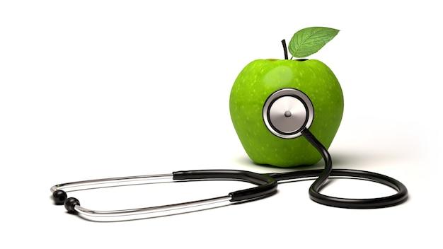 Estetoscopio y manzana verde