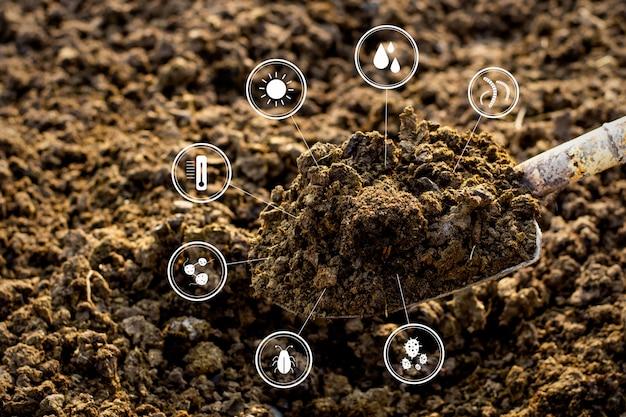 Estiércol con icono de tecnología alrededor, agrícola.