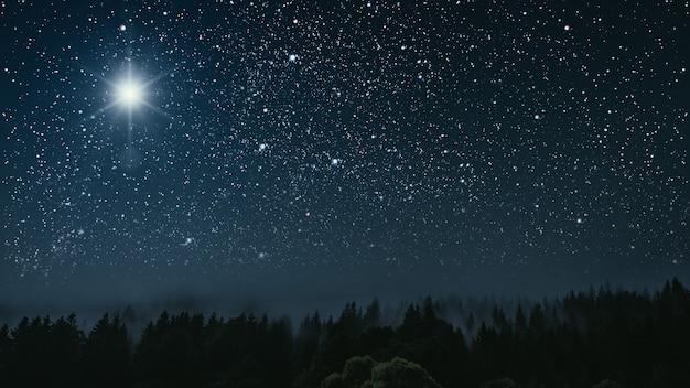 Estrella brilla sobre el pesebre de navidad de jesucristo.