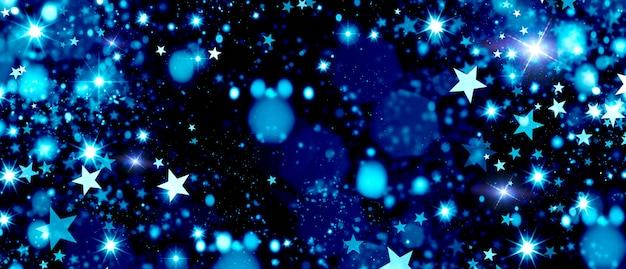 Estrellas de bokeh azul brillante en la noche de navidad cielo festivo fondo de invierno para el diseño
