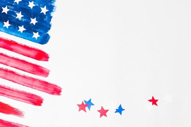 Estrellas rojas y azules con la bandera americana pintada de los eeuu en el fondo blanco