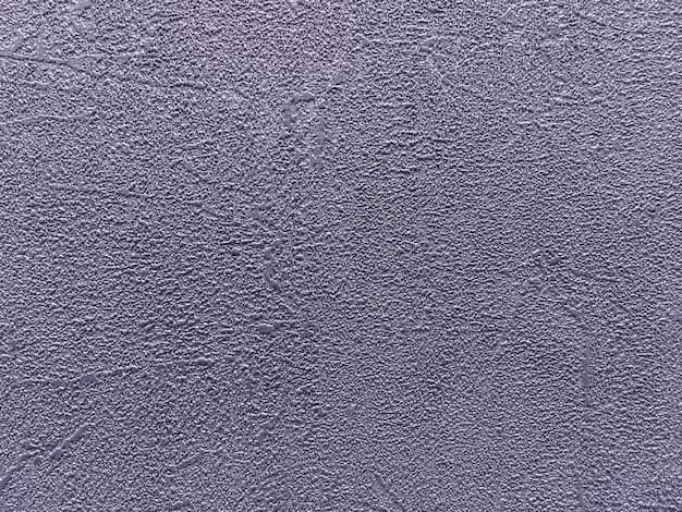 Estructura de fondo abstracto en forma de un parche áspero irregular de color marrón grisáceo.