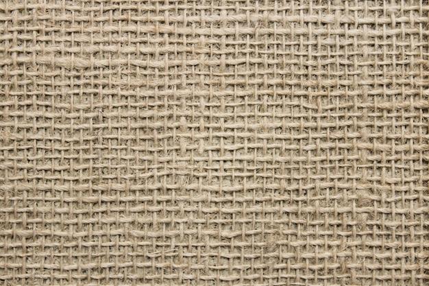 La estructura de la tela de lino gruesa como superficie.