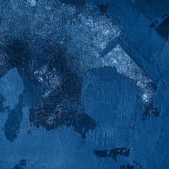 Estuco decorativo azul oscuro con malla de tela azul. fondo de textura atmosférica envejecida