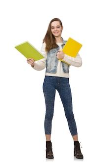Estudiante bonito que sostiene los libros de texto aislados en blanco