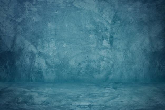 Estudio de pared de cemento azul y fondo de piso en blanco