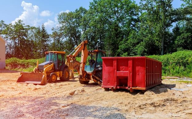 Excavadora amarilla de nueva construcción tractoras excavadoras y contenedores de basura