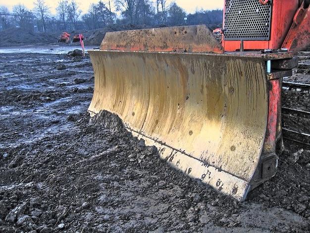 Excavadoras tierra trabajo sitio de la demolición de la construcción
