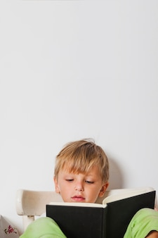 Excited boy reading book