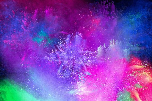 Explosión de colores para happy holi en polvo. fondo de explosión de polvo de color.