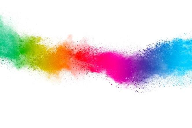 Explosión de polvo multicolor sobre fondo blanco. nube coloreada polvo de colores explota pai