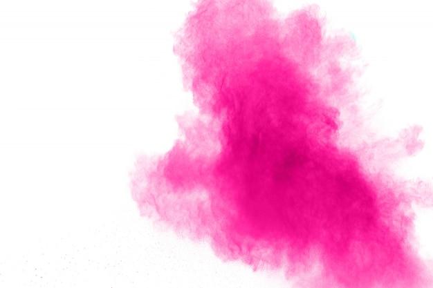 Explosión rosada abstracta del polvo en el fondo blanco.