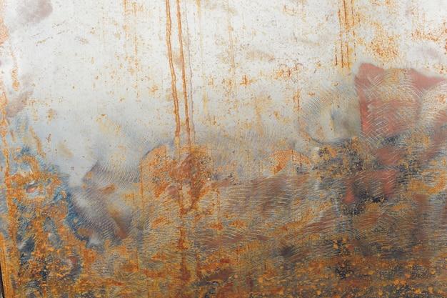 El extracto corroyó el fondo oxidado colorido del metal, textura oxidada del metal.