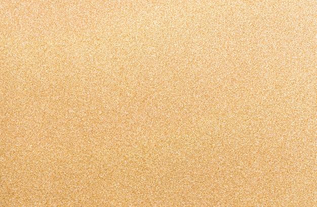 El extracto refleja el fondo de la textura del papel del color oro