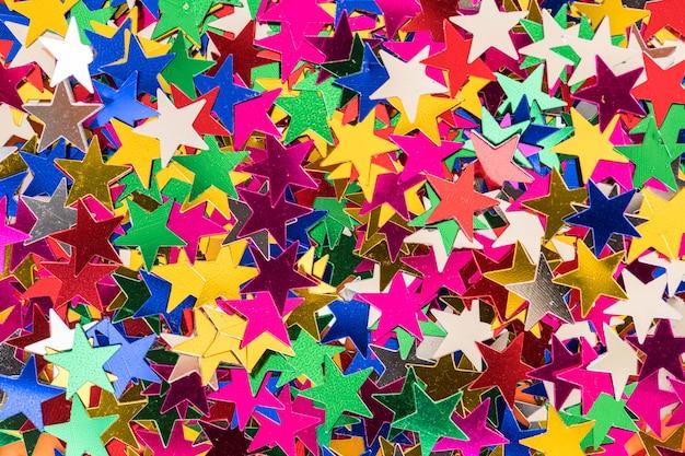 Extracto texturizado brillo colorido del fondo de la lentejuela de la estrella