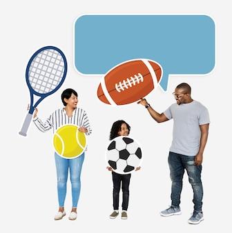 Familia feliz con los iconos del deporte