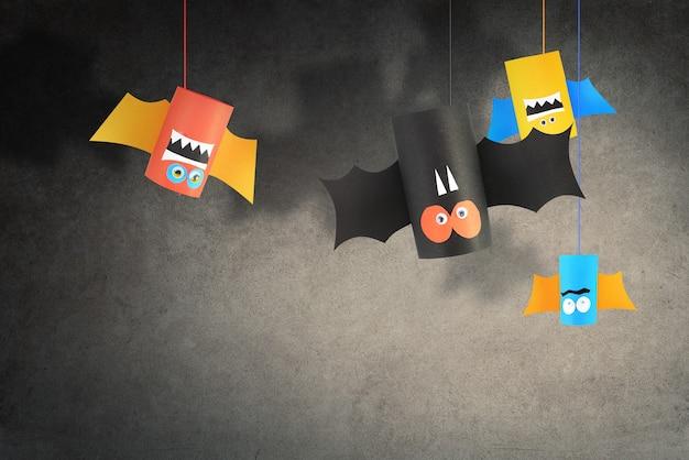 Familia de murciélagos de halloween para el fondo del concepto de halloween. manualidades de papel diy.