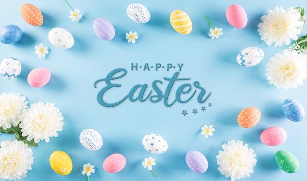 ¡felices pascuas! coloridos huevos de pascua con flor en azul pastel