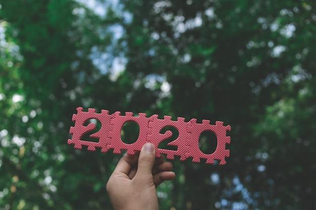 Feliz año nuevo 2020. feliz año nuevo 2020. símbolo del número 2020