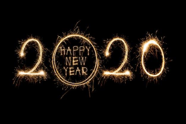 Feliz año nuevo 2020. texto creativo feliz año nuevo 2020 escrito espumosos brillantes aislados