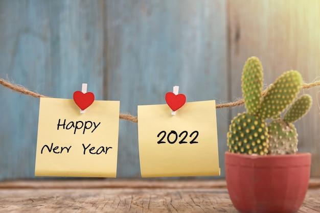 Feliz año nuevo 2022 diseño de nota de fondo