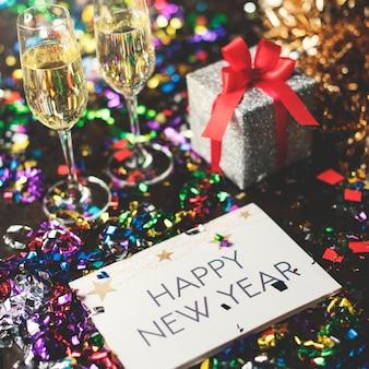 Feliz año nuevo palabra en celebración de vacaciones de tarjeta