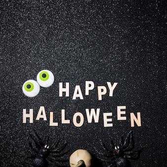 Feliz composición de halloween con espacio de copia en la parte superior