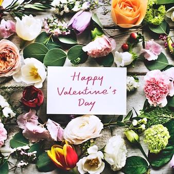 Feliz día de san valentín tarjeta y flores