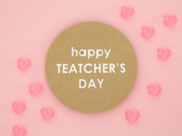 Feliz dia del maestro corazones rosados