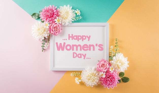 Feliz día de la mujer concepto hermosa flor con marco de imagen