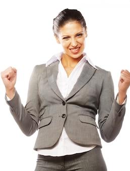 Feliz ganador. exitosa mujer de negocios celebrando con los brazos arriba.