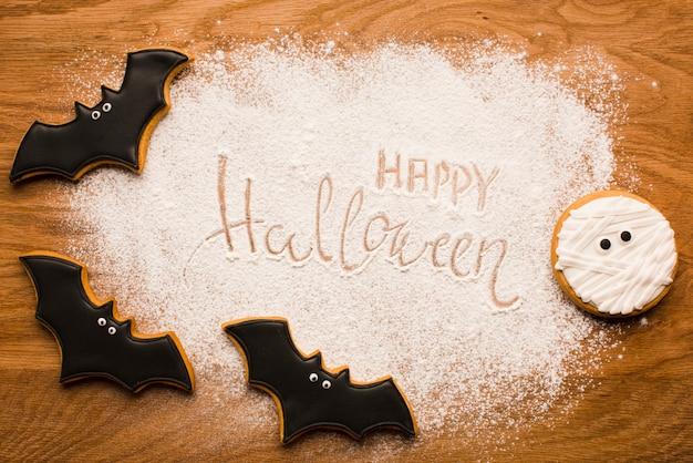 Feliz halloween murciélagos en mesa de madera