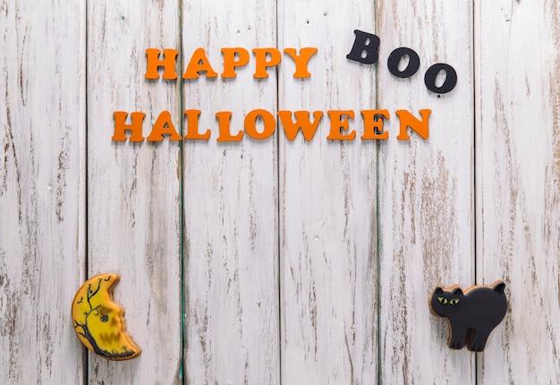 Feliz halloween subtítulo y dos galletas lindas