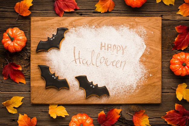 Feliz halloween en tablero de madera con murciélagos