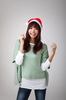 Feliz navidad alegre niña en rojo tenía, retrato de portarretrato.
