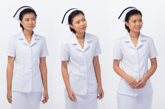 Figura de medio cuerpo de 20 años mujer asiática desgaste enfermera uniforme blanco falda y zapatos, fondo blanco aislado