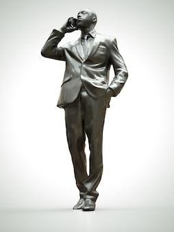 Figura de plástico de un hombre negro en un traje hablando por teléfono
