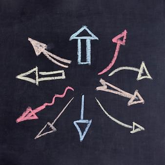 Flechas dibujadas que apuntan en cualquier dirección