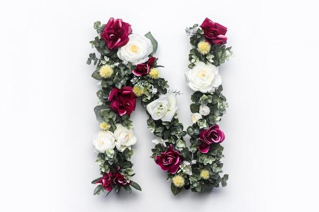 Flor letra n floral monograma foto gratis