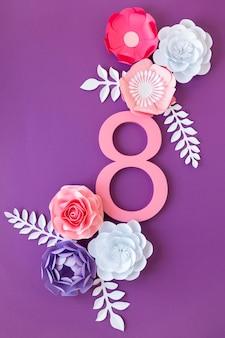 Flores de fecha y papel para el día de la mujer