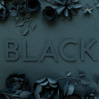 Flores de papel negro sobre fondo negro