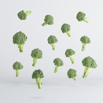 Flotación vegetal del bróculi en el fondo blanco. idea mínima concepto de comida.