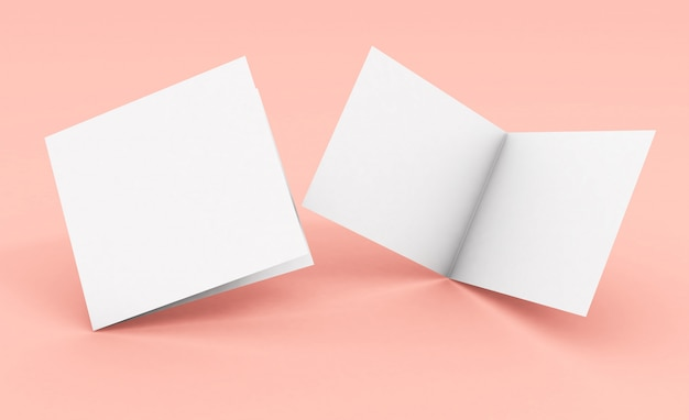 Folleto plegable cuadrado en blanco sobre superficie rosa