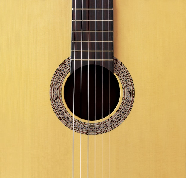 Fondo abstracto agujero de guitarra clásica española de madera con cuerda de nylon en
